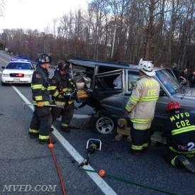 Firefighters operate on the scene of a serious motor vehicle accident on Point Lookout Road at the entrance to Birch Manor