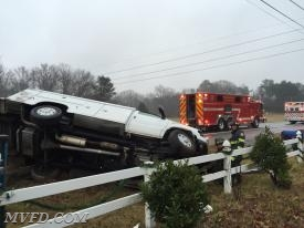Firefighters operate on the scene of this overturned vehicle on Three Notch Road in Laurel Grove