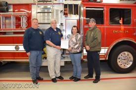 Chief Raley, President Smith with Bakerton President Smith and Captain Whittington with the Bill of Sale officially competing the transfer of paperwork on the purchase of E-24