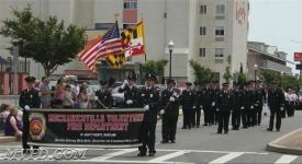 "The Men and Women of ""The Village"" Marching up the street in Ocean City."