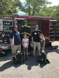 FF Dickerson and FF Carter pose for a picture with their kids
