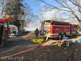 Firefighters operate on a shed fire off of Thompson Corner Road