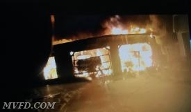 Firefighters work a garage fire off of West Spicer Drive in Country Lakes