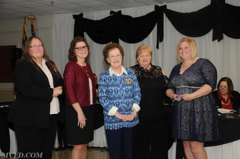 The Guy Family presenting Auxiliary President Molly Colonna with the Elaine Guy Award.