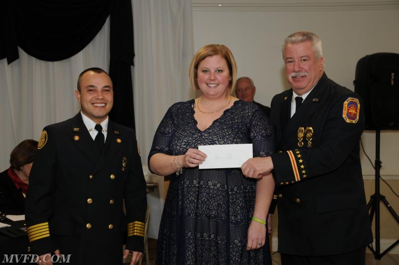 Auxiliary President Molly Colonna presents Chief Trowbridge and President Montgomery with a check from the Auxiliary