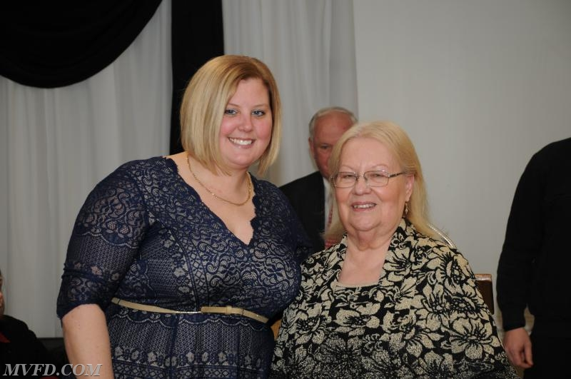 Auxiliary President Molly Colonna presents Lorraine Ferguson with her Length of Service Award for 5 years.