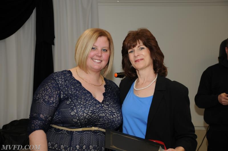 Auxiliary President Molly Colonna presents Ida Abell with her Length of Service Award for 30 years.
