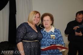 Auxiliary President Molly Colonna presents Peggy Guy with her Length of Service Award for 60 years.