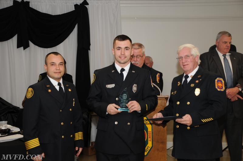 President Montgomery, Chief Trowbridge and 1st Vice President Dennis Bellevou presents Tyler Burroughs with his Length of Service Award for 5 years.