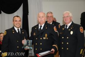 President Montgomery, Chief Trowbridge and 1st Vice President Dennis Bellevou presents Willie Wilkerson with his Length of Service Award for 45 years.