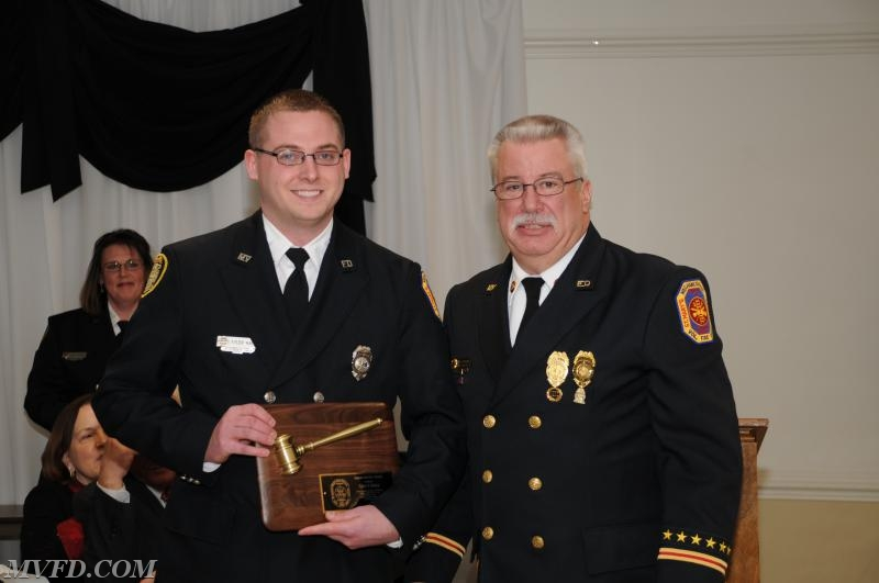 President Montgomery presents Tyler Raley with a Special Service Award.