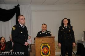 Chief Trowbridge and Assistant Chief Scott Bellevou presents Tyler Raley with the Chief's Award.