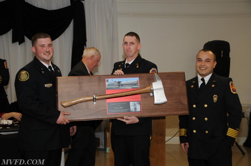 Assistant Chief Scott Bellevou and Chief Mark Trowbridge presents Daniel Busl  with the Firefighter of the Year Award.