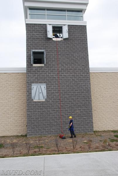 Crews rappelling from the training tower.