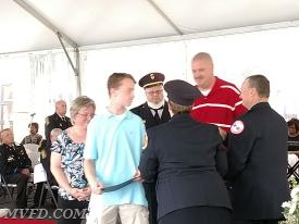 Mike Pilkerton, Jr. and family accepts the certificate for his father Michael Pilkerton, Sr. at the Memorial Service.