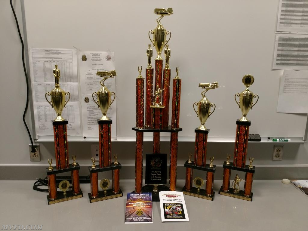 Convention programs with trophies.