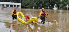 Raft 2 retrieving one subject that became trapped in a building after flood waters rose.