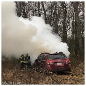 Firefighters operate on an auto fire off Thompson's Corner Road