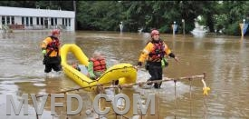 Rescue Squad 2 assisting a citizen thru flood waters.