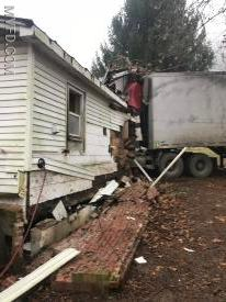 Structural Collapse after a tractor trailer stuck an occupied home.