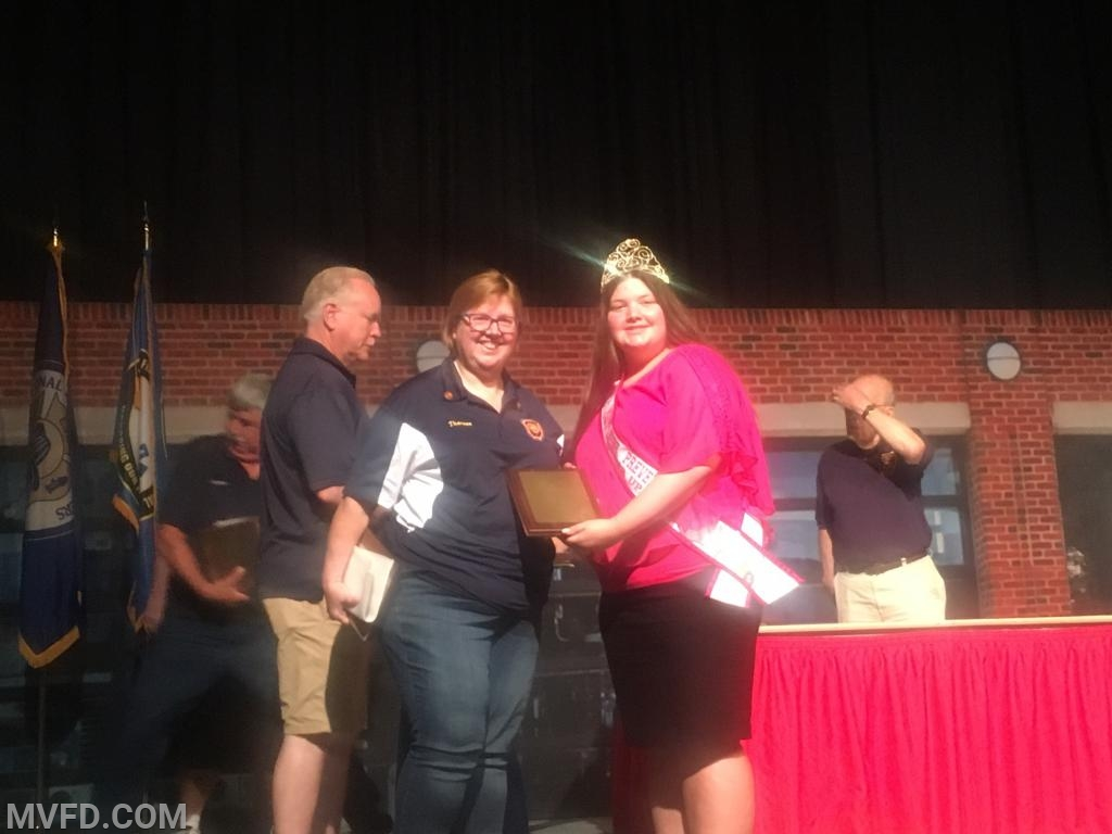 Fire Prevention Officer Theresa Palmer accepting her award.