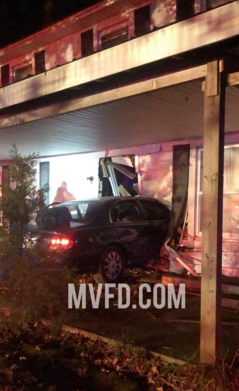 One Transported after Car Strikes Residence