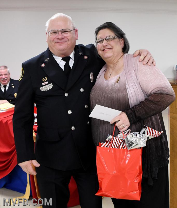 Auxiliary President Cindy Turner presenting Pop Barnes with a thank you gift for helping the Auxiliary last year