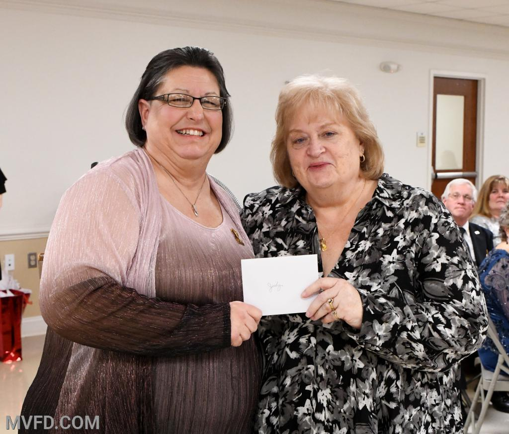 Auxiliary President Cindy Turner presenting Past Auxiliary President Judy Copsey with a thank you gift for her help and guidance during the past year