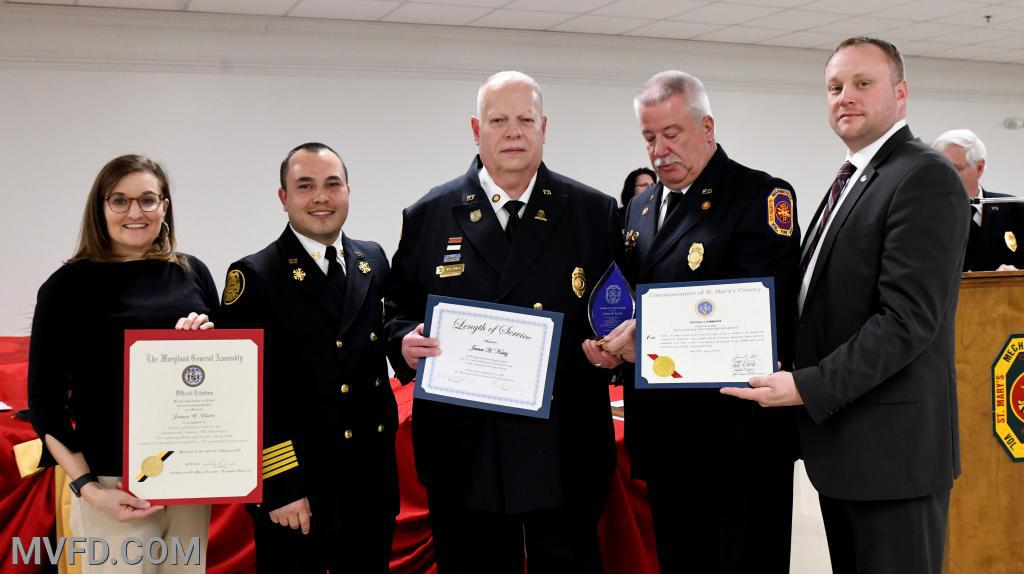 Karin Bailey, Chief Trowbridge, President Montgomery and Commissioner John O'Connor presenting James Kurtz certificates for 25 Years of Service