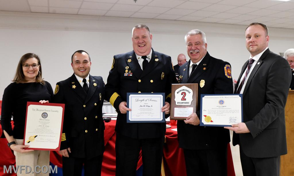 "Karin Bailey, Chief Trowbridge, President Montgomery and Commissioner John O'Connor presenting John ""TBone"" Raley certificates for 35 Years of Service"