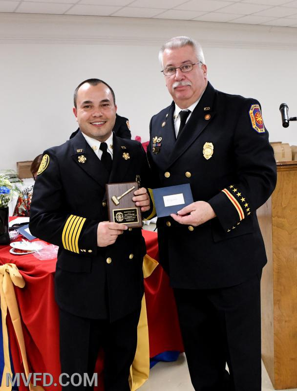 "President John ""Monkey"" Montgomery presenting Chief Mark Trowbridge with a Special Service Award"