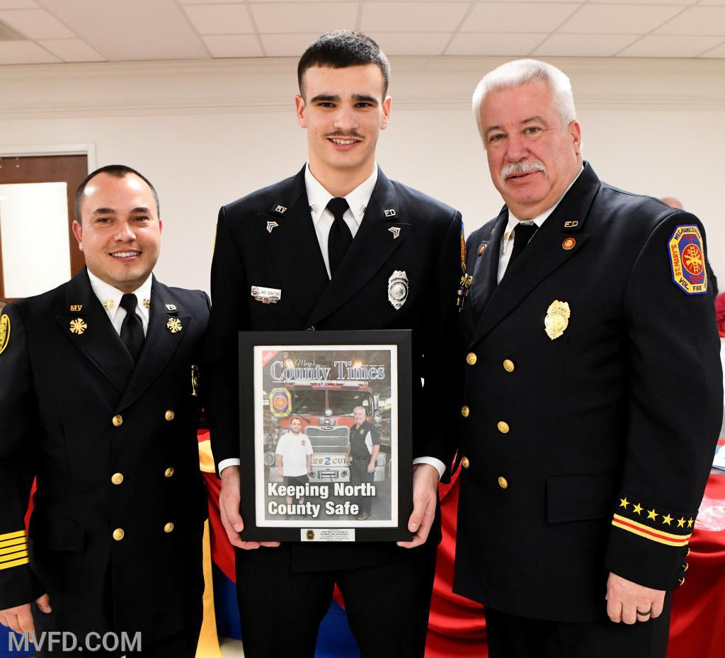 Jake Senatore presented Chief Trowbridge and President Montgomery with their framed picture that was on the cover of the County Times Newspaper.
